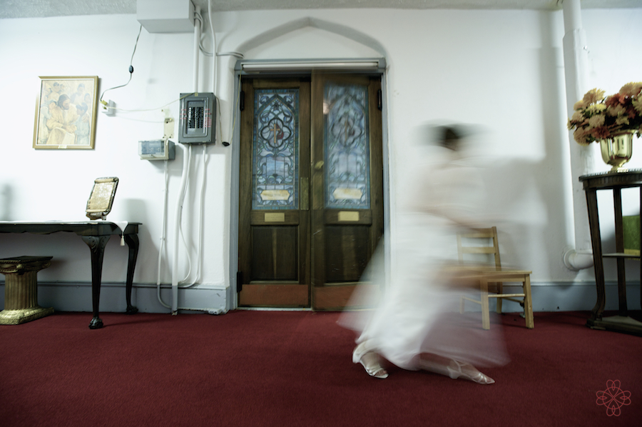 The door to the sancturary swings back and forth as the flowergirl passes by at St. James Methodist Church.
