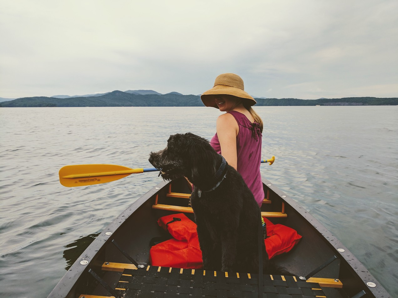 Girl and a dog in a canoe on Lake Jocassee
